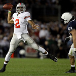 Ohio State quarterback Terrelle Pryor (2) scrambles and throws as Penn State defender as Penn State linebacker Josh Hull (43) moves in during the second half of an NCAA college football game …