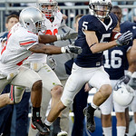 Ohio State's Russell Anderson (21) and Austin Spitler (38) chase down Penn State's Graham Zug (5) during the first half of an NCAA college football game in State College, Pa., Saturday, Nov. …