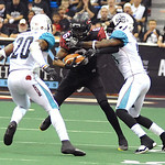 Gladiators' wide receiver Thyron Lewis is brought down by Arizona Rattlers' defensive backs Arkeith Brown and Jeremy Kellem.  KRISTIN BAUER | CHRONICLE