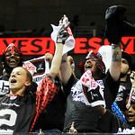 Fans decked out in red and black and costumed in various helmets cheer for the Gladiators against the Arizona Rattlers on Saturday. KRISTIN BAUER | CHRONICLE