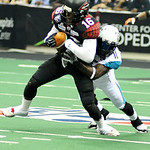 Gladiators' wide receiver Dominick Goodman is brought down by Arizona Rattlers' defensive back Arkeith Brown. KRISTIN BAUER | CHRONICLE