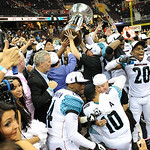 The Arizona Rattlers cheer as they receive their Arena Bowl XXVI trophy after defeating the Gladiators, 72-32. KRISTIN BAUER | CHRONICLE