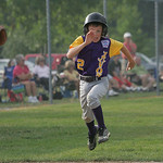 Matt South of Avon runs with intensity towards home plate in a big inning.    photo by Chuck Humel