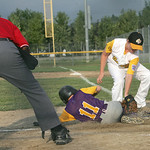 Avon #11 Connor O&#039;Malley slides in safe as Cuyahoga Falls North pitcher Alex Hass lays a late tage on him.   photo by Chuck Humel
