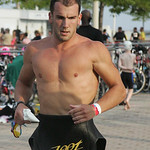 Adam Kuncel of Amherst heads for his bicycle after swimming 1.5k in the Cleveland Triathlon.