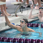 Ben Brooks of Avon, left, and Braid Grant of Amherst/St. Edwards check the scoreboard after the 200 individual medley. RAY RIEDEL/CHRONICLE