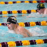 Avon's Ben Brooks leads St. Edward's Grant Braid, from Amherst, in the 200 yard IM during the Sectional Swimming Championship at Lakewood. RAY RIEDEL/CHRONICLE