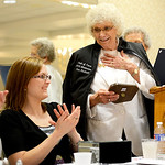 Newly inducted Hall of Fame member Ann Rudisill smiles after receiving her award as she shares a laugh with Bowler of the Year Amanda Morrow. KRISTIN BAUER | CHRONICLE