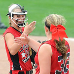 Elyria pitcher April Howser and Faith Hamilton high five before the start of their game against Indiana. KRISTIN BAUER | CHRONICLE