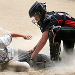 Vermilion's Joseph Sheets slides into home as Elyria catcher Gage Norris tags him for the out. KRISTIN BAUER | CHRONICLE