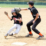 Vermilion DRD's Kidge Clark hits third baseman Matthew Beck's glove as he slides into third base in the fourth inning of the Hot Stove Class G regional championship game yesterday at Reservo …