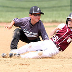 Vermilion Impact's Jack Wells puts the tag down on Wellington Rampage's Garrett Kropff at second for the out in the Hot Stove Class H regional championship game yesterday at Reservoir Park i …