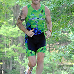 Aaron Henely of Grafton finishes running in the Huntington triathlon June 23.  Steve Manheim