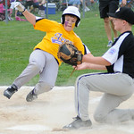 Avon's Jacob Eirmann slides safely into homeplate as Cuyahoga Falls pitcher Brady Semick attempts to tag him out at home. KRISTIN BAUER | CHRONICLE
