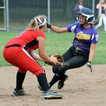 Avon's Kayla Graham is tagged out at second base by Elyria's Gabby Shackleford. STEVE MANHEIM/CHRONICLE