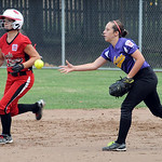 Avon's Jess Morrison tosses the ball to get out Elyria's Alexis Reinhardt. STEVE MANHEIM/CHRONICLE