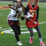 Avon Lake's Kerry Gray and Brecksville's Tayler King battle for the ball. STEVE MANHEIM/CHRONICLE