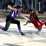 Elyria Little League's Emma Barnes is tagged out at home by Avon pitcher Taylor Graham. KRISTIN BAUER | CHRONICLE