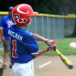 Elyria East Little League right fielder Kaden Gunselman bats. KRISTIN BAUER | CHRONICLE