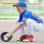 Elyria East Little League relief pitcher Jordan Lamb fields a ball. KRISTIN BAUER | CHRONICLE
