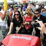 Courtney Force briefly visits with her fans at the Summit Racing Equipment NHRA Finals on July 5.  KRISTIN BAUER | CHRONICLE