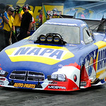 Crew members plug their ears and shield their faces as NAPA Auto Parts driver Ron Capps revs his engine on July 6.  KRISTIN BAUER | CHRONICLE