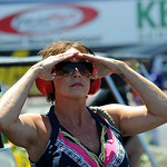 Jennifer Johnson, with the Lester Johnson top sportsman team, watches NHRA qualifying at Norwalk on July 4. STEVE MANHEIM/CHRONICLE