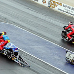 Scotty Pollacheck (left) and Matt Smith (right) race for the win in the Pro Stock Motorcycle class in the 2013 Summit Racing Equipment NHRA Nationals yesterday at Summit Motorsports Park in  …