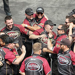 Khalid Albalooshi's pit crew celebrates as he wins the Top Fuel class defeating Doug Kalitta in the Summit Racing Equipment NHRA Nationals yesterday at Summit Motorsports Park in Norwalk. (C …