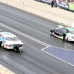 Ron Capps, left, and Johnny Gray, right, race in the final of the Pro Funny Car class of the 2013 Summit Racing Equipment NHRA Nationals yesterday at Summit Motorsports Park in Norwalk. Gray …