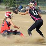 Baylee Price of Ohio Power Red slides safe into third before the throw reaches Emily Telscher of Explosive Fast Pitch at North Ridgeville on June 30. Steve Manheim