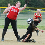 Crushers' Kylie Bishop beats the tag from Firelands' short stop Kylie Dickman. KRISTIN BAUER | CHRONICLE