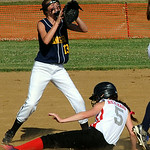 Columbia Vitamix's Alexis Reichard steals second base before the ball reaches North Ridgeville's Emily Reynolds. STEVE MANHEIM/CHRONICLE