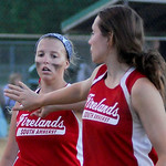 After a rough inning against Buckeye, Firelands' Emma Ranney high fives pitcher Claire Vilagi.   KRISTIN BAUER | CHRONICLE