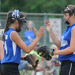 Grafton high fives before the start of an inning against Firelands. KRISTIN BAUER | CHRONICLE