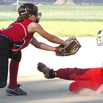 South Amherst Synergy's #17 Larren Rounds is able to slide under the tag of Amherst Wranglers' #7 Mackenzie Cornwell. (CT photo by Linda Murphy.)