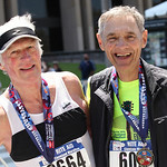 Running partners Richard Pool, 73, of South Amherst, and Jim Mackert, 77, of Elyria, pose moments after completing the 37th Rite Aid Cleveland Marathon together.  RAY RIEDEL/CHRONICLE