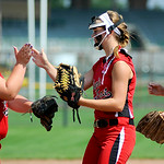 Elyria high fives after pitcher April Howser's strikes out an Illinois batter. KRISTIN BAUER | CHRONICLE