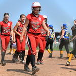Elyria walks off the field after a hard-fought game against Illinois on Monday. KRISTIN BAUER | CHRONICLE