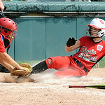 Elyria East's Alexis Reinhardt is tagged out at the plate by Missouri's Molly Chandra. STEVE MANHEIM/CHRONICLE
