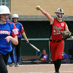 April Howser throws to first base for the out. STEVE MANHEIM/CHRONICLE
