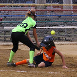 Lorain Xplosion's Paige Barricklow slides safely in at home against Sheffield Magic pitcher Sarah Torres. CHRISTY LEGEZA/CHRONICLE