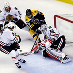Boston Bruins center Rich Peverley (49) drives to the net against Chicago Blackhawks goalie Corey Crawford, right, as Chicago Blackhawks defensemen Brent Seabrook (7) and Duncan Keith (2) de …