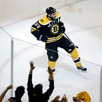 Boston Bruins center Patrice Bergeron celebrates his goal against the Chicago Blackhawks during the second period in Game 3 of the NHL hockey Stanley Cup Finals in Boston, Monday, June 17, 2 …