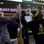 Boston Bruins fan Matt Kona, right, of Boston, wearing a bear costume trades a high-five with a fan entering TD Garden for Game 3 of the NHL hockey Stanley Cup Finals between the Bruins and …