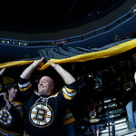 Boston Bruins fans pass a large banner through the stands before Game 3 of the NHL hockey Stanley Cup Finals against the Chicago Blackhawks in Boston, Monday, June 17, 2013. (AP Photo/Elise  …