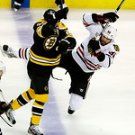 Boston Bruins center Chris Kelly (23) checks Chicago Blackhawks defenseman Michal Rozsival (32), of the Czech Republic, during the first period in Game 3 of the NHL hockey Stanley Cup Finals …