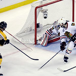 Boston Bruins center Patrice Bergeron (37) scores a goal past Chicago Blackhawks goalie Corey Crawford (50) and defenseman Brent Seabrook (7)during the second period in Game 3 of the NHL hoc …
