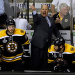 Boston Bruins head coach Claude Julien shouts instructions to his team between center Tyler Seguin (19) and left wing Milan Lucic (17) during the third period in Game 3 of the NHL hockey Sta …