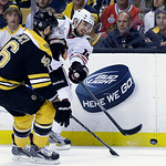 Chicago Blackhawks center Marcus Kruger, right, fires the puck past Boston Bruins center David Krejci (46), of the Czech Republic,  during the first period in Game 3 of the NHL hockey Stanle …